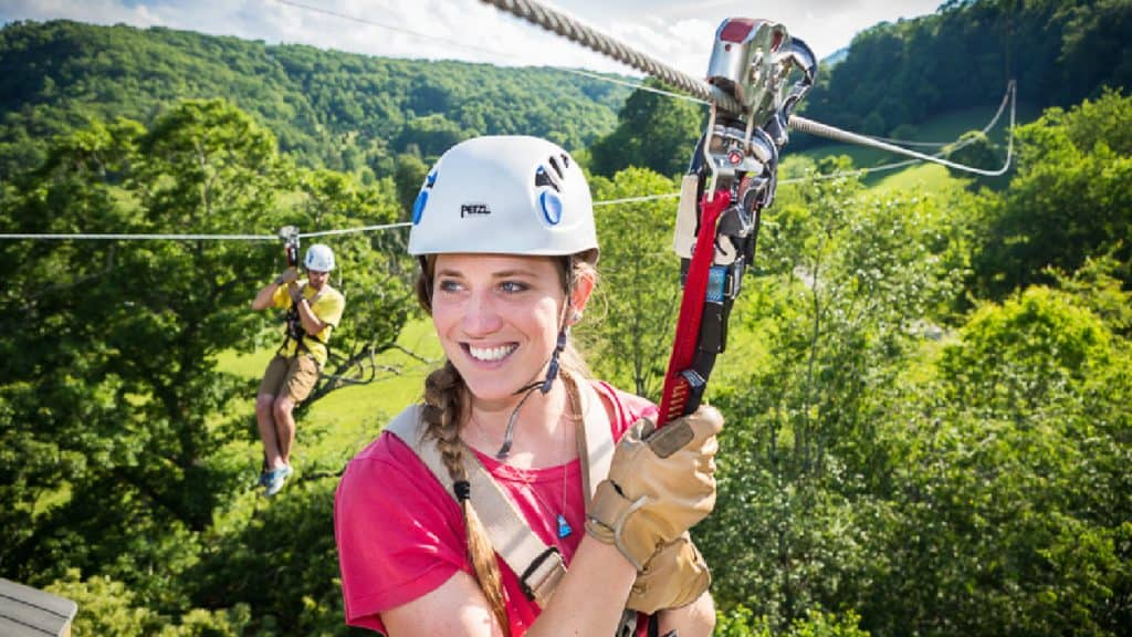 beautiful girl with beautiful smile enjoying a zip line tour