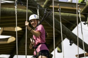 young-girl-smiling-aerial-adventure-park-high-gravity-adventures