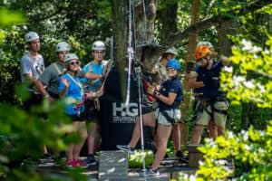 HGA Staff and Guest on Zip Platform