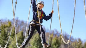 Teenager on aerial adventure course in Blowing Rock, NC