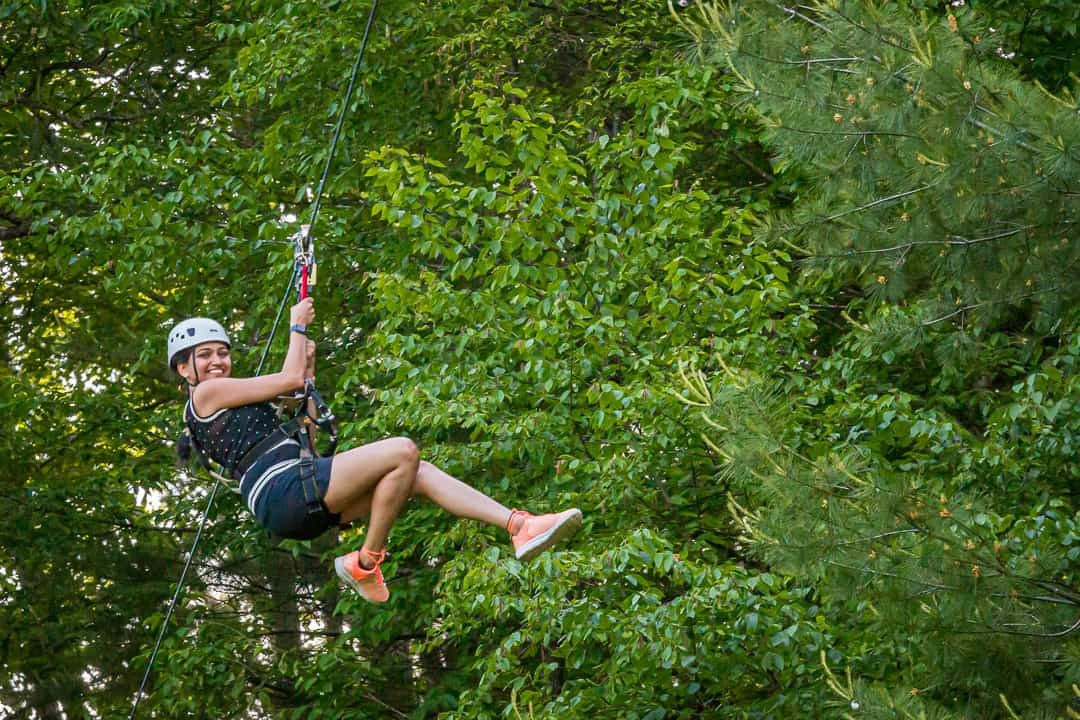 Woman Zipping on Mega Zipline
