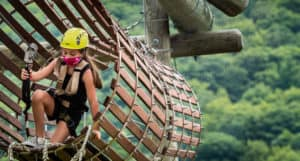 Girl traverses adventure park with Covid precautions