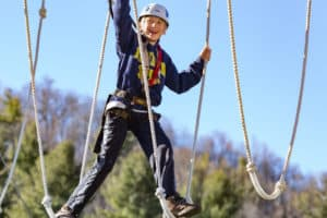 Young Teen Traverses Challenge Course/Aerial Park Element