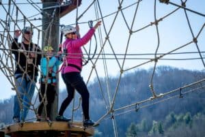 Mom and kid on adventure course