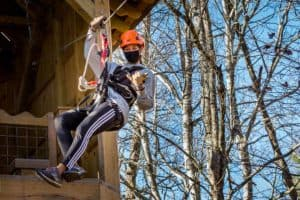 Woman ziplining leaving platform